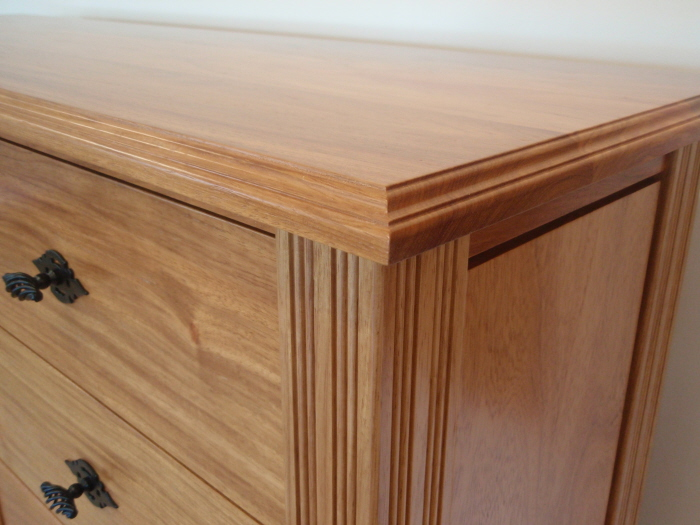 corner detail of CD cabinet in New Guinea Rosewood