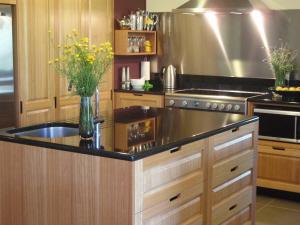 Bespoke kitchen in Tasmanian Oak and jet black granite