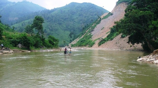 motorcycle crossing river on a bamboo raft (Ha Giang, Vietnam)