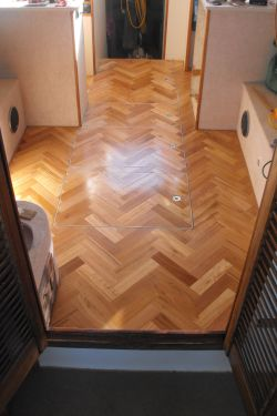 Custom parquetry floor (removable hatches) river boat